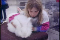 Alaska State Fair, young girl and rabbit, 4H entry, Palmer, Alaska Stock Footage