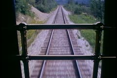 The Alaska Railroad, close up of retreating tracks from rear of train Stock Footage