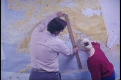 Seismology center, map on wall, scientists inspect, University of Alaska Stock Footage