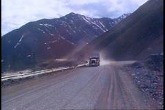 Semi-tractor trailer, climbing mountain on gravel Dalton highway in Alaska Stock Footage