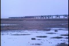 Pipeline out over icy swamp-like patch, Deadhorse, Prudhoe Bay, Alaska Stock Footage