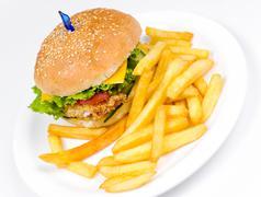 Cheeseburger with deep fried potatoes Stock Photos