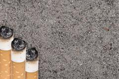 Butts against the tobacco ash Stock Photos