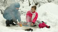 Couple Sitting by Bonfire in Winter Forest Stock Footage