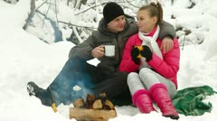 Winter Holidays Near Bonfire In Snow - stock footage
