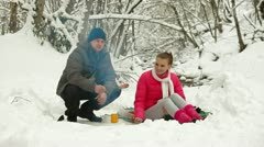 Teenage Couple  By Bonfire in Snow Forest Stock Footage