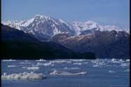 Columbia Glacier, Alaska, POV passing through ice filled waters, mountains Stock Footage