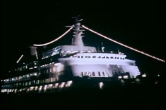 Cruise Ship The Island Princess, The Love Boat, at night, lit up Stock Footage