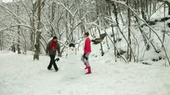 Funny Teenage Couple Enjoying in Snow and Winter Stock Footage
