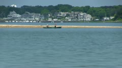 Kayaking along sandbar Stock Footage