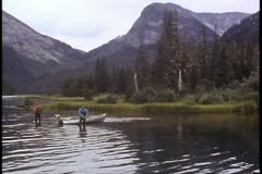 Fisherman standing in the water, trout fishing, Alaska, Inside Passage Stock Footage