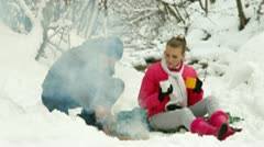 Winter Holidays by Bonfire in Snowy Forest - stock footage