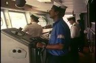 Island Princess, The Love Boat, cruise ship bridge, helmsman controls wheel Stock Footage
