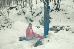 Teenage Couple Enjoying Winter Holidays in Forest Stock Footage