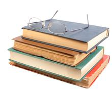 glasses and group of old dirty books - stock photo