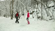 Stock Video Footage of Funny Teenage Couple Enjoying in Snow and Winter