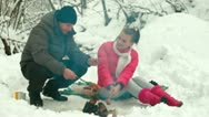 Stock Video Footage of Winter Picnic By Bonfire in Snow Forest