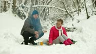 Stock Video Footage of Teenage Couple  By Bonfire in Snow Forest