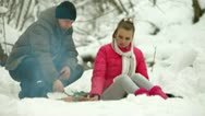 Stock Video Footage of Teenage Couple in Winter Forest