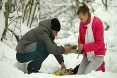 Teenage Couple in Winter Forest By Bonfire Stock Footage