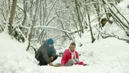 Stock Video Footage of Teenage Couple in Winter Forest By Bonfire