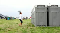 Attractive woman using a portable bathroom facility Stock Footage