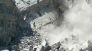 Stock Video Footage of Slow-motion rock fall in open pit mine