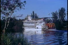 Riverboat Yukon River, Alaska, paddlewheel, wide passby, mirror reflection Stock Footage