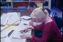 Seismology center, graphs on table, scientists inspect, University of Alaska Stock Footage