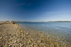 Pebble beach in Bibinje Stock Photos