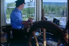 Riverboat on Yukon River, Alaska, paddlewheel, Captain at the giant wheel Stock Footage