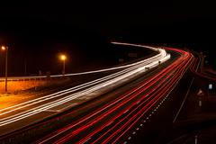 Long exposure photo of traffic on the move at dusk on the motorway Stock Photos