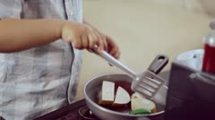 Baby boy cooking Stock Footage