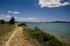 Narrow path to the sea Stock Photos