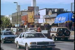 Anchorage, Alaska, 1988 main street, shops and traffic, crushed Stock Footage