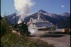 White Pass & Yukon Railroad, Alaska, steam engine passes, ship behind - stock footage