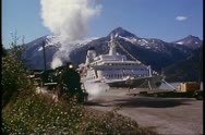 Stock Video Footage of White Pass & Yukon Railroad, Alaska, steam engine passes, ship behind