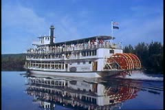 Riverboat on Yukon River, Alaska, paddlewheel, mirror reflection, passby Stock Footage