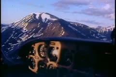 Aerial trip, POV over Brooks Range, Alaska, midnight in June, plane panel Stock Footage