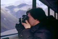 Coach passenger takes photograph out of window, Dalton Highway, Alaska Stock Footage