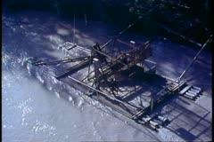 Fish wheel turning on the Yukon River , river bank, medium shot, Alaska Stock Footage