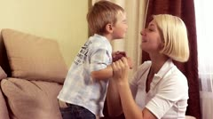 Mother playing with her baby boy at home Stock Footage
