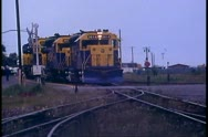 Three diesel locomotives in a row, crushed shot, head on, gray sky Stock Footage