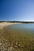 Pebble beach in the Sukosan marina Stock Photos