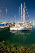 Berthed ships and yachts Stock Photos