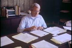 Fairbanks, Alaska, Native corporation, Douyon Ltd, offices, man at desk - stock footage