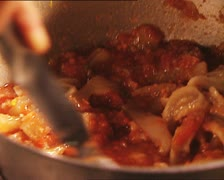 FOOD cooking stirring tomato soup with pork rind AUDIO Stock Footage
