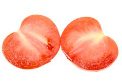 two cross of a ripe red tomato - stock photo