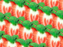 background of strawberry slices and green leaf - stock photo