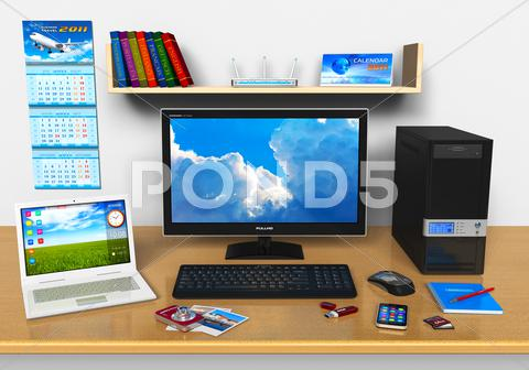 Stock photo of Office workplace with desktop computer, laptop and other devices